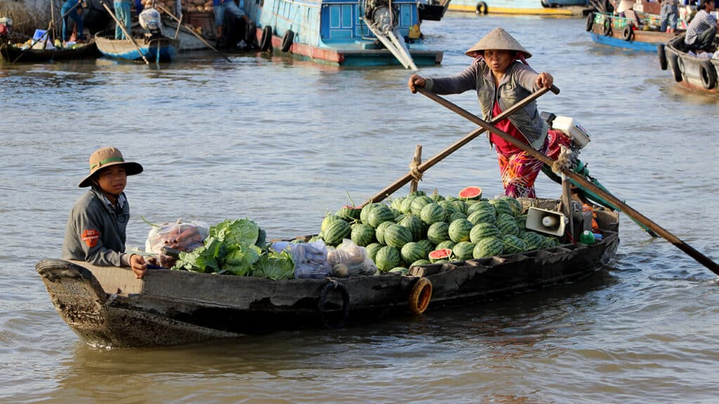 Mekong Delta floden - En dame som sælger vandmeloner fra sin båd